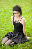 Girl in gothic style on grass — Stock Photo