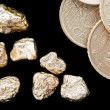 Gold nuggets and money — Stock Photo