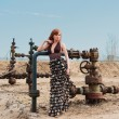 Women and oil well — Stock Photo