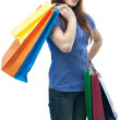 Beauty shopping woman with clored bags — Stock Photo