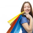 Stock Photo: Beauty shopping woman with clored bags