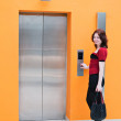 Stock Photo: Womwith elevator