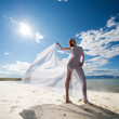 Woman in white on coast of sea — Stock Photo