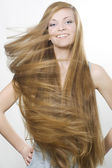 Smiling blond with great long hair — Stock Photo