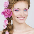 Woman with roses in hair — Stock Photo