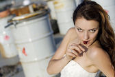 Bride on the road eating cherry — Stock Photo