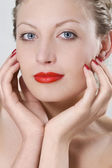 Photo of a beautiful woman with red lips — Stock Photo