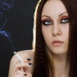 Young woman smoking — Stock Photo #3401308