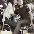 Stock Photo: Smiling couple on the carousel