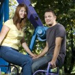 Young couple on the carousel — Stock Photo