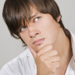 Handsome young man thinking — Stock Photo #3611208