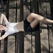Beautiful girl lying on the stairs — Stock Photo