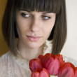 Young woman holding bouquet — Stock Photo
