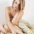 Sexyl naked girl sitting on bed — Stock Photo #3712027