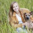 Stock Photo: Beautiful girl and her dog