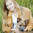 Beautiful girl and her dog — Stock Photo #3863319