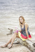Beautiful young woman at the sea — Stock Photo