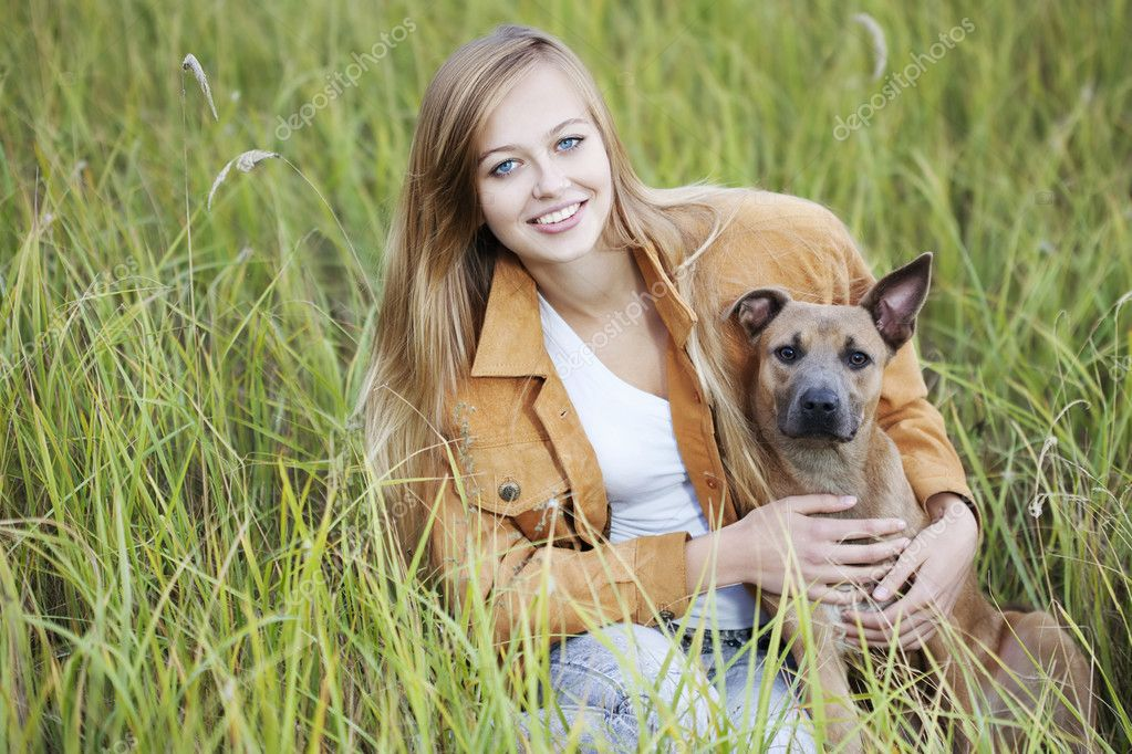 Young beautiful girl and her dog — Stock Photo #3863310