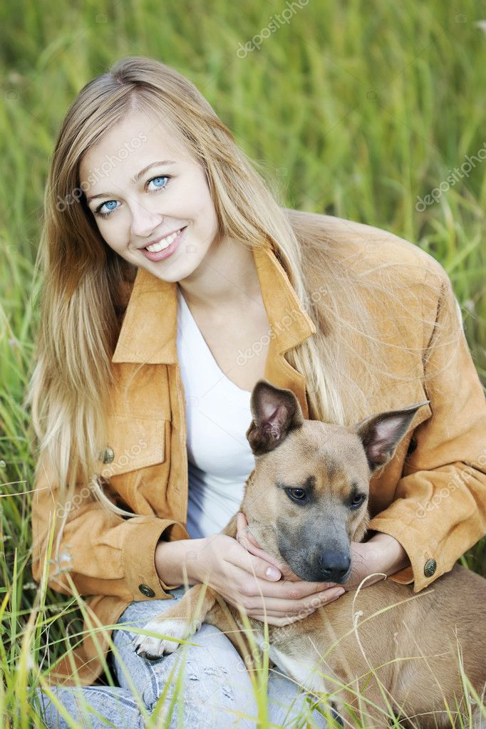 Young beautiful girl and her dog — Stock Photo #3863319