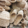Many basketry: sandals, hats — Stock Photo