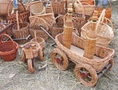 Wicker products: baskets, carts, bottles — Stock Photo