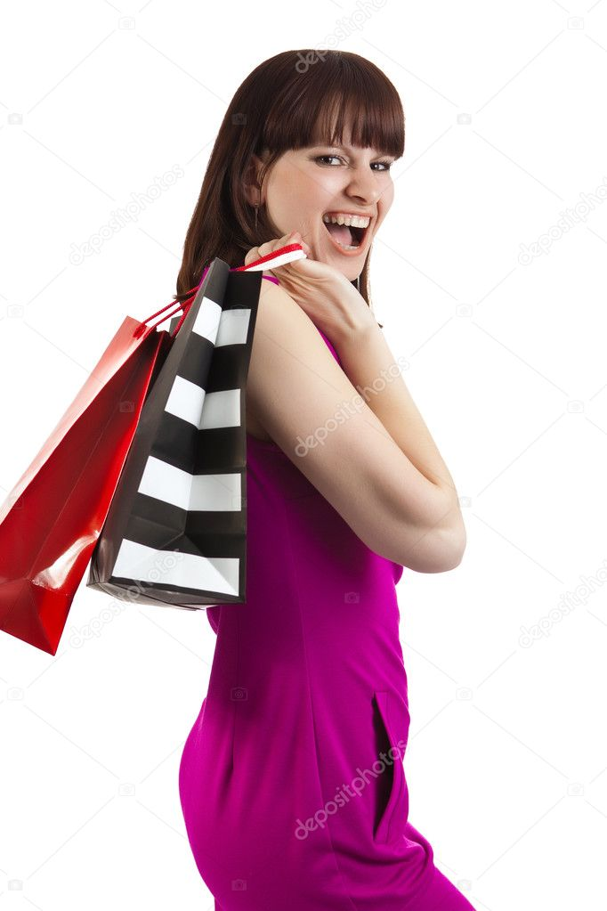 Laughing woman in violet dress with the shopping bags. Isolated on white. — Stock Photo #2925638