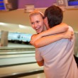 Happy couple in the bowling club — Stock Photo