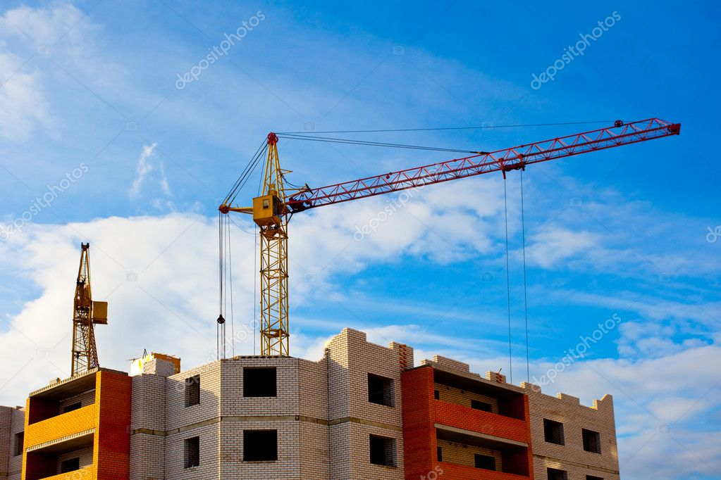Two cranes and unfinished house construction — Stock Photo #2775316