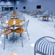 tables and chairs in cafe — Stock Photo