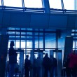 Crowd silhouettes in the office - Stock Photo