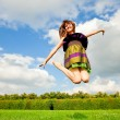 Pretty smiling girl is jumping — Stock Photo