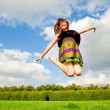 Stock Photo: Pretty smiling girl is jumping