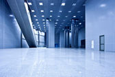 Empty blue hall — Stock Photo
