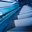 Escalator in blue corridor - Stock Photo