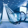 Escalator in blue corridor — Stock Photo #3075744