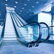 Escalator in blue corridor — Stock Photo