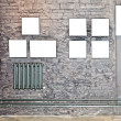 Empty frames on brown brick wall - Stock Photo