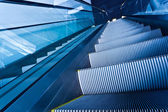 Escalator in blue corridor — Stock Photo