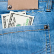 Jeans pocket with dollars banknotes — Stock Photo