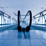 Escatator in blue hall — Stock Photo