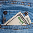 Jeans pocket with dollars banknotes — Stockfoto
