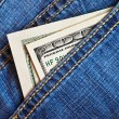 Jeans pocket with dollars banknotes — Stock Photo #3160067