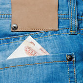 Jeans pocket with banknotes — Stock Photo