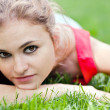 Stock Photo: Attractive girl lay on grass