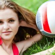Attractive girl lay on grass — Stock Photo