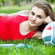 Royalty-Free Stock Photo: Attractive girl lay on grass