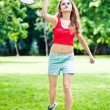 Girl in red play badminton — Stock Photo #3537086