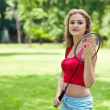 Stock Photo: Girl in red with badminton rocket