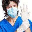 The portrait of doctor in gloves - Stock Photo