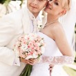Happy young couple of bride and groom — Stock Photo